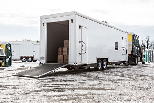 A large trailer with the rear loading door open