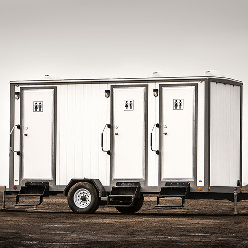 A trailer containing 3 separate washrooms
