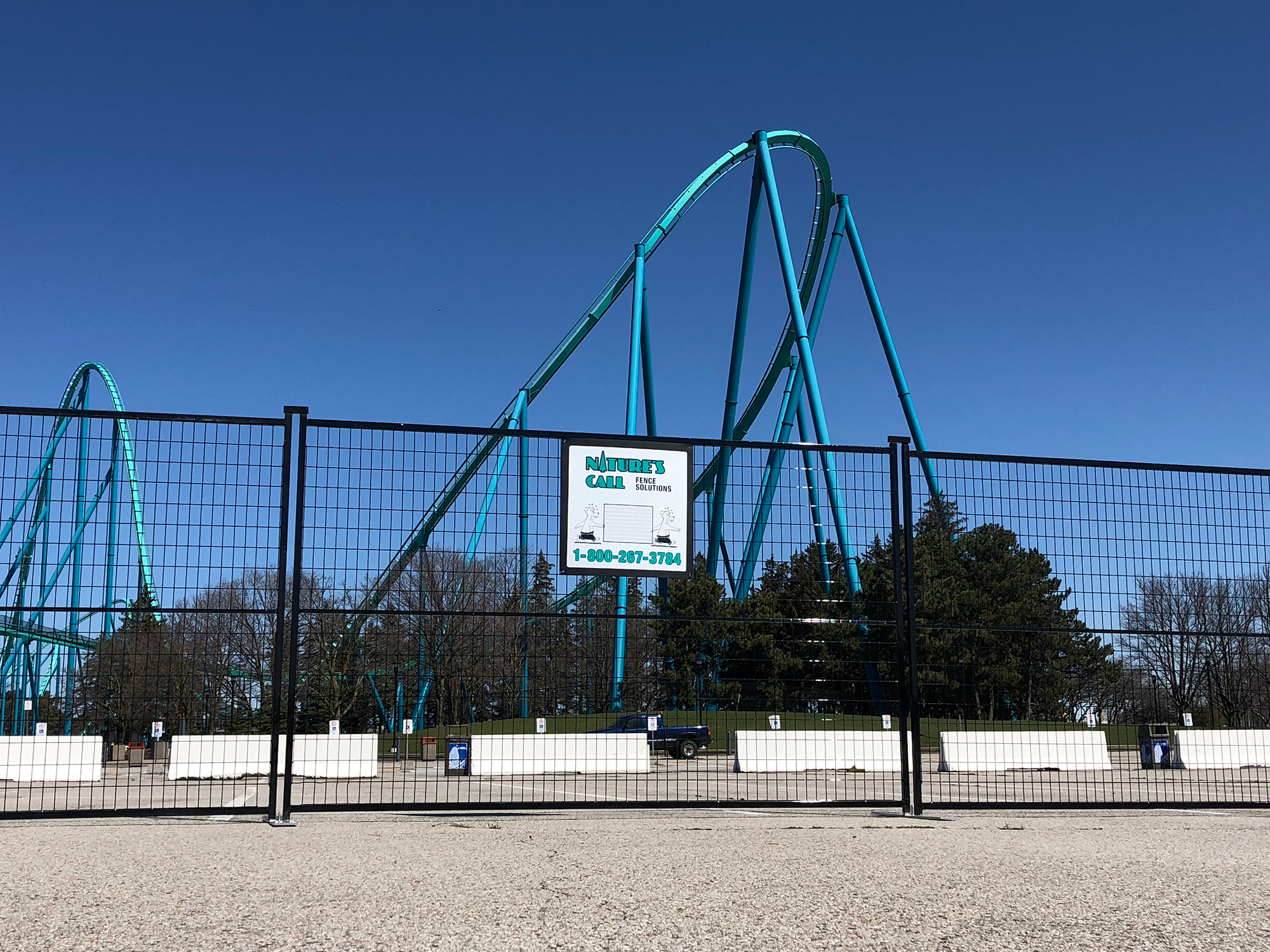 A 6-foot tall fence surrounds a roller coaster at Canada's Wonderland